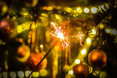 New year party sparkler. Sparkler on bokeh background. Christmas theme Stock Images