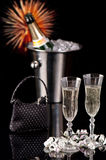 New Year Party Time. New Year party with glasses of champagne, ice bucket, cocktail bag and fireworks Stock Image