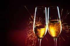 New Year party time with two champagne glasses and sparklers aga stock photography