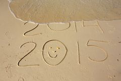 New Year. 2014 passing away on the beach Stock Photo
