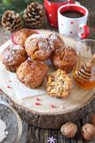 New Year pastry: spiced honey muffins with walnuts and coffee. New Year pastry: spiced honey muffins with walnuts, two cups of coffee and pine cones Stock Photo