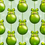 New Year pattern with ball. Christmas wallpaper with bow and ribbon. Royalty Free Stock Photos
