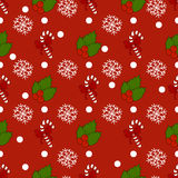 New Year pattern with christmas decoration elements. Happy holidays pattern with christmas candy and  snow on a red background. Stock Image