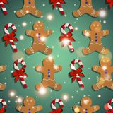 New year pattern with the gingerbread man and candy striped Royalty Free Stock Photography