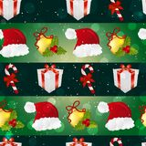 New year pattern with Santa hat, gift, Christmas tree toys, and striped candy Royalty Free Stock Images