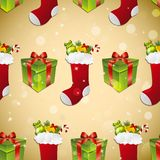 New year pattern with sock for gifts and gift. Sparkles and bokeh. Shiny and glowing Royalty Free Stock Photos