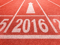 2016 new year perspective and success concept. White digids on red running track Royalty Free Stock Photography