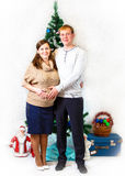 New Year photo of young husband and pregnant wife in retro style Royalty Free Stock Photos