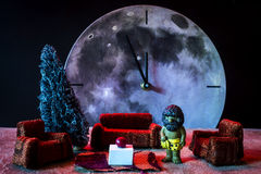 New Year waiting made with a toy and a moon clock Stock Photography