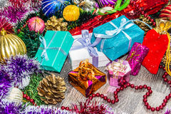 New year picture. Gifts boxes, Christmas decorations, tinsel and beads Stock Photo