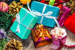 New year picture. Gifts boxes, Christmas decorations, tinsel and beads Royalty Free Stock Photo