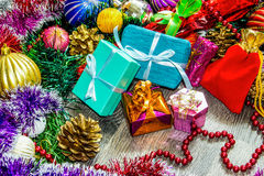 New year picture. Gifts boxes, Christmas decorations, tinsel and beads Stock Images