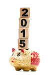 New Year 2015:  piggy bank and building blocks Stock Photos