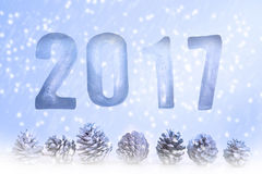 New Year 2017 with pinecones and snowflakes. Numbers 2017 as ice cubes with white pinecones on blue background and snowflakes stock illustration