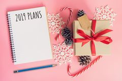 2019 New Year Plans, top view brown gift box, notebook and chris stock photos