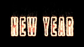 New year plasma text from fire isolated in black stock footage