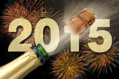 New year 2015. Popping champagne with firework at new year 2015 stock image