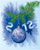 New Year postcard with Christmas-tree decoration. Ball with symbol 2012 dragon Stock Photos