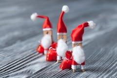 New year postcard design. Clothespin Santa Claus. Royalty Free Stock Image