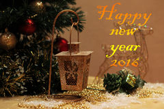 New Year postcard. Golden Christmas flashlight on the background of Christmas tree with the inscription Happy New Year 2016 Royalty Free Stock Photography