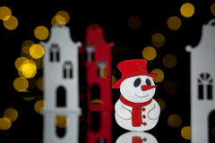 New year postcard with toy houses and snowman; Royalty Free Stock Photo