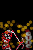 New year postcard with toy mitten, candy cane and snowman; Stock Image