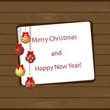 New year poster with Christmas balls sign hanging. On the wall of wooden planks. Template for greeting card or invitation on the occasion. Vector illustration Stock Photo