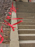 New Year praying. Red ribbon in front of the temple to pray for family, friends, the world, peace and happiness in the coming year stock image