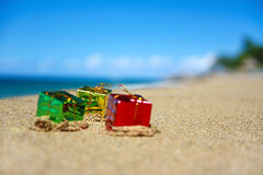 New year present boxes on caribbean beach. New year present boxes on tropical beach Stock Photo