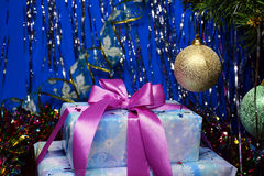 New Year present and Christmas ball. Christmas present under a Christmas tree Stock Images