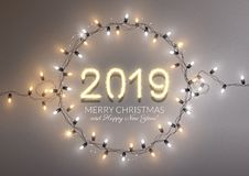 2019 new year realistic gold text numbers and lightbulbs, Christmas. Lights, postcard, banner, vector illustration stock illustration