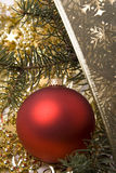 New-Year red ball. New-year toys red ball and branch of fir Royalty Free Stock Photography