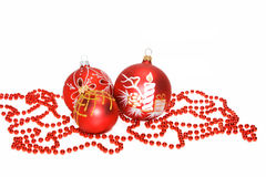 New-year red balls. And beads on a white background Stock Photos