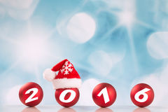 New year 2016 on red balls. New year 2016 on christmas bauble with Santa's hat royalty free stock image