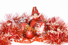 New-year red balls and elf. On a white background Royalty Free Stock Images