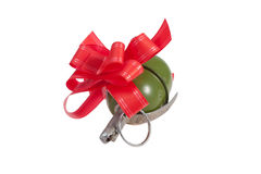 New year red gift with hand grenade Stock Photo