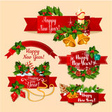 New Year red ribbon banners. New Year ribbon banners set. Red label with holly berry and pine twig, candy cane and bauble ball, bell and candle, gingerbread and Stock Photography