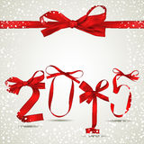 New Year. Red ribbons with snowfall Stock Photography