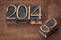 New year 2014. Replacing old year 2013 - letterpress wood type on a grunge wooden surface Stock Photography