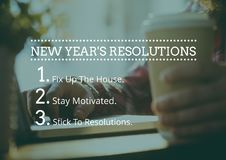 New year resolution goals against hand holding coffee cup stock images