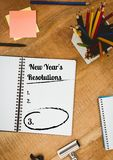 New year resolution goals with office supplies on wooden table. List of new year resolution goals with office supplies on wooden table Royalty Free Stock Photo