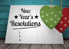 New year resolution goals written on card against wooden background Stock Photos