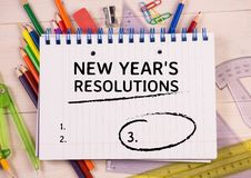 New year resolution goals written on spiral diary Stock Photography
