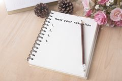 New year resolution list on notecook beginning goal concept. Royalty Free Stock Photography