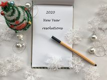 New Year Resolutions. 2020 New Year. New Year Concept. White Notebook Sheet With Pen On White Background Covered With Christmas De Royalty Free Stock Image