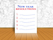 New year resolutions on bokeh wall background. New year resolutions on white bokeh wall background Royalty Free Stock Images