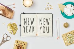 New Year resolutions concept with notepad and gift boxes on whit royalty free stock photos
