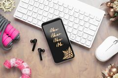 2021 New Year resolutions  healthy goals background concept. New Year New Me text on mobile phone on table with jump rope,