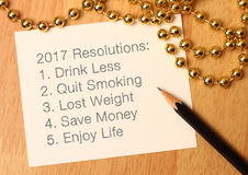 New year resolutions. 2017 resolutions list with gold decoration vector illustration