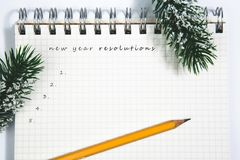 New year resolutions, open blank spiral notepad with yellow penc Stock Images